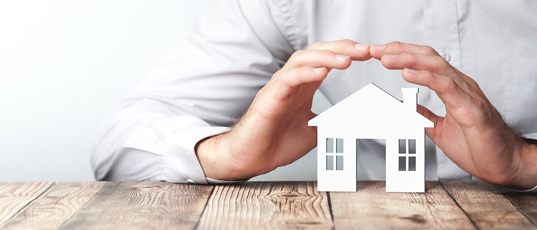 Protecting Hands Over House - Home Security And Protection Conce